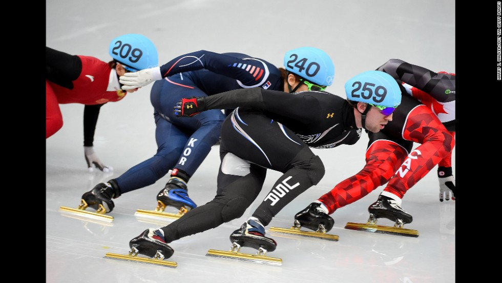 American Chris Creveling, center, competes during a men's 1,000-meter short track speedskating race on February 15.