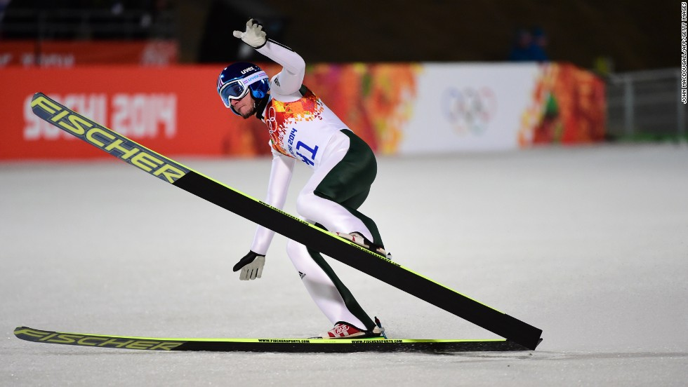 Slovenia's Robert Kranjec reacts in the finish area during the first round of the men's large hill ski jumping event.