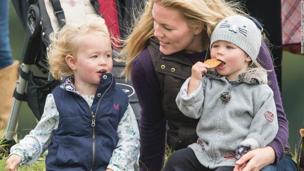 Autumn Phillips, the wife of Peter Phillips, attends the Gatcomb Horse Trials in Minchinhampton, England, with daughters Isla and Savannah in September 2013. Peter Phillips is the oldest grandchild of Queen Elizabeth II and Prince Philip.
