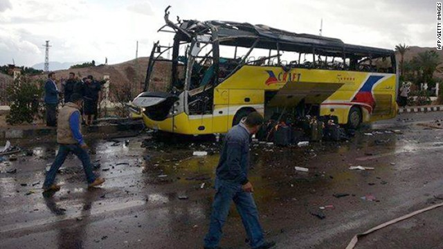 A picture taken on February 16, 2014 show the wreckage of a tourist bus at the site of a bomb explosion in the Egyptian south Sinai resort town of Taba. A bomb tore through a bus carrying sightseers near an Egyptian resort town bordering Israel, police officials said. AFP PHOTO / STR-/AFP/Getty Images Credit: 	AFP/Getty Images