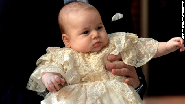 CROOPED VERSION Britain's Prince William, Duke of Cambridge holds his son, Prince George of Cambridge, as he arrives at Chapel Royal in St James's Palace in central London for the christening of the three month-old baby on October 23, 2013. Prince William and his wife Catherine gather close friends and family on Wednesday for the christening of their baby son Prince George, in a low-key ceremony far removed from the global hype surrounding their wedding. AFP PHOTO/POOL/JOHN STILLWELL (Photo credit should read JOHN STILLWELL/AFP/Getty Images)
