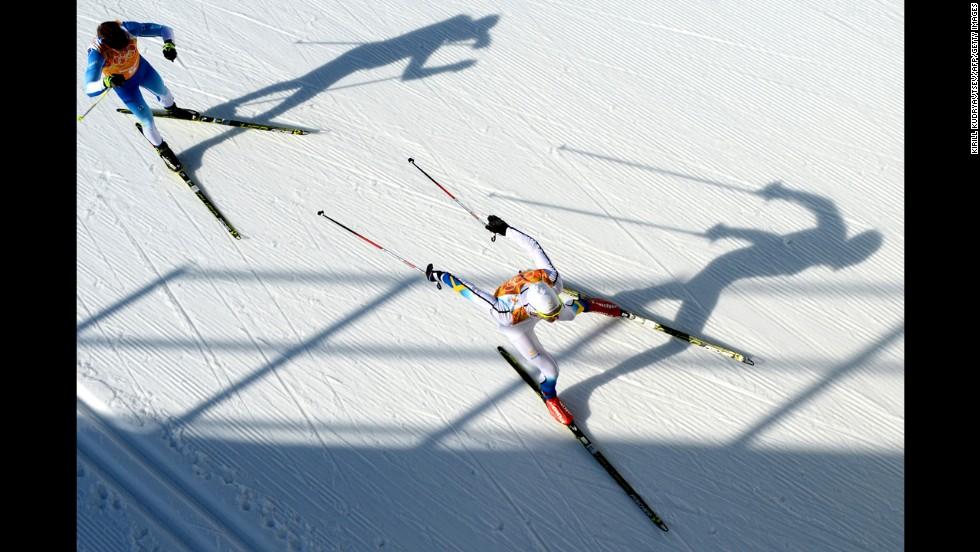 Finland's Lari Lehtonen and Sweden's Johan Olsson compete in the men's cross-country relay on February 16.