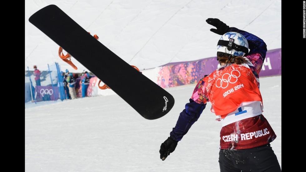 Czech athlete Eva Samkova throws her snowboard as she celebrates winning the final of the women's snowboard cross on February 16.