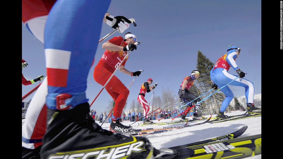 Skiers compete in the men's cross-country relay on February 16.