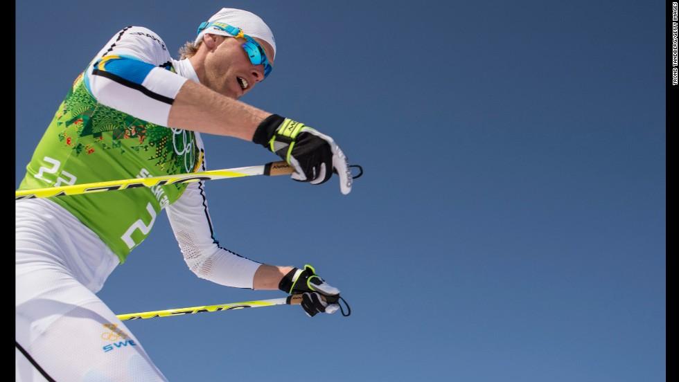 Sweden's Johan Olsson skis during the men's cross-country relay.