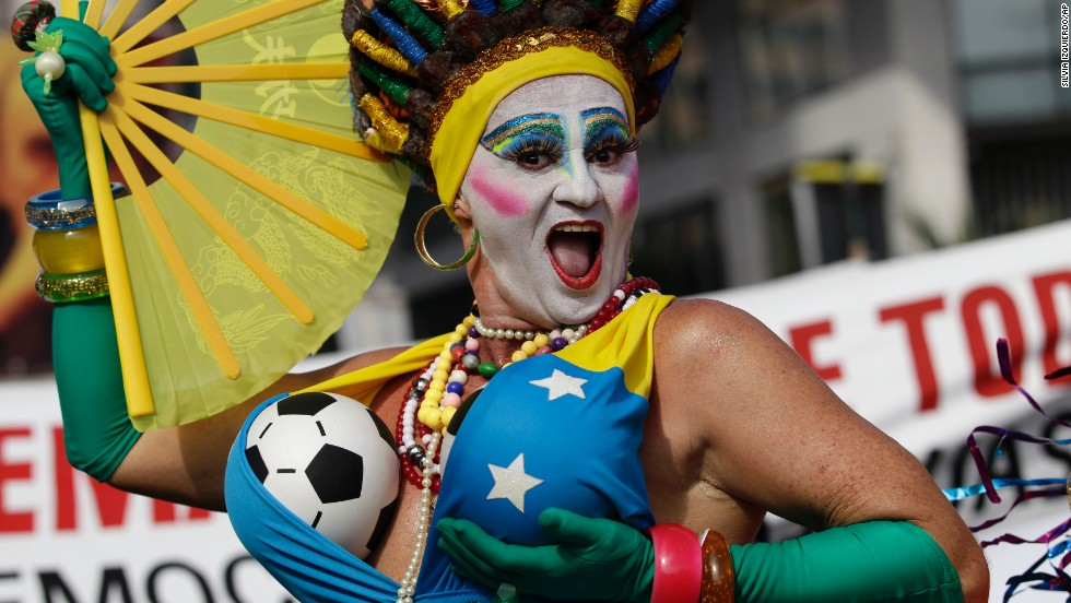 A reveler poses for photos at the Banda de Ipanema carnival parade in Rio de Janeiro on February 15.