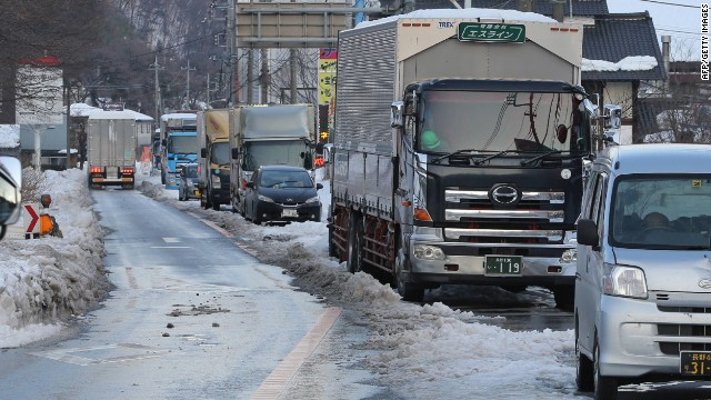Trucks and vehicles are stuck on the road of National Route 18 in Annaka city in Gunma prefecture on February 17, 2014.