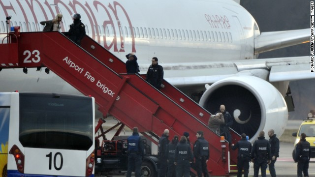 Police evacuate passengers on February 17, 2014 from the Ethiopian Airlines flight en route to Rome, which was on hijacked and forced to land in Geneva, where the hijacker has been arrested, police said.