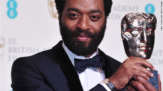British actor Chiwetel Ejiofor poses with the award for a leading actor for his work on the film '12 Years a Slave' at the BAFTA British Academy Film Awards at the Royal Opera House in London on February 16, 2014.
