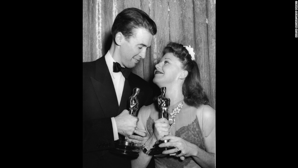 "Actors James Stewart and Ginger Rogers smile after winning Oscars in 1941. Stewart won best actor for his performance in ""The Philadelphia Story,"" while Rogers won best actress for her performance in ""Kitty Foyle: The Natural History of a Woman."""