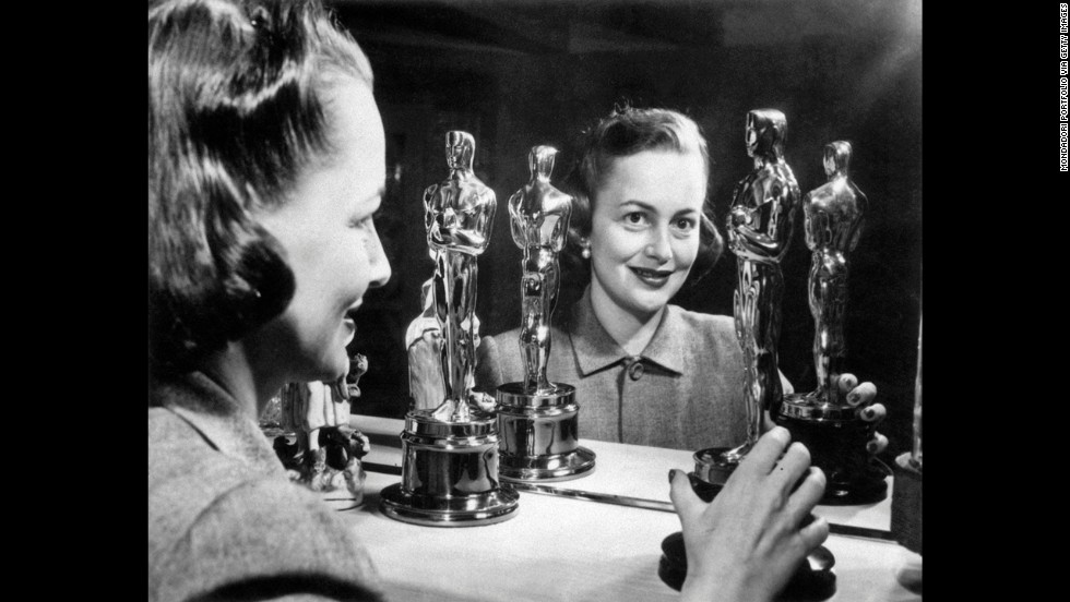 "Olivia de Havilland looks at her two best actress Oscars. She won her second in 1950 for her role in ""The Heiress."""