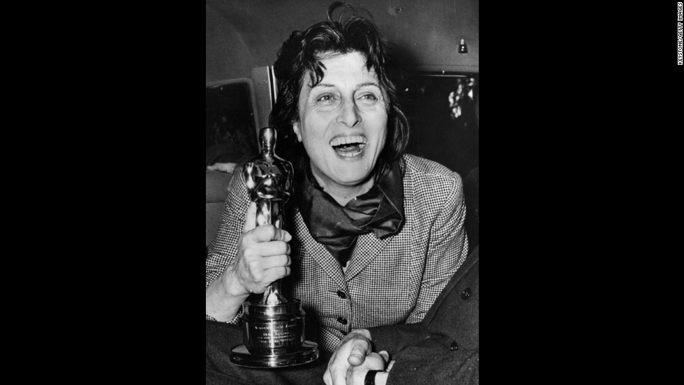 "Anna Magnani enthusiastically holds the Oscar she won for ""Rose Tattoo."" The award was presented to her by U.S. Ambassador Clare Luce at the Villa Taverna in Rome."