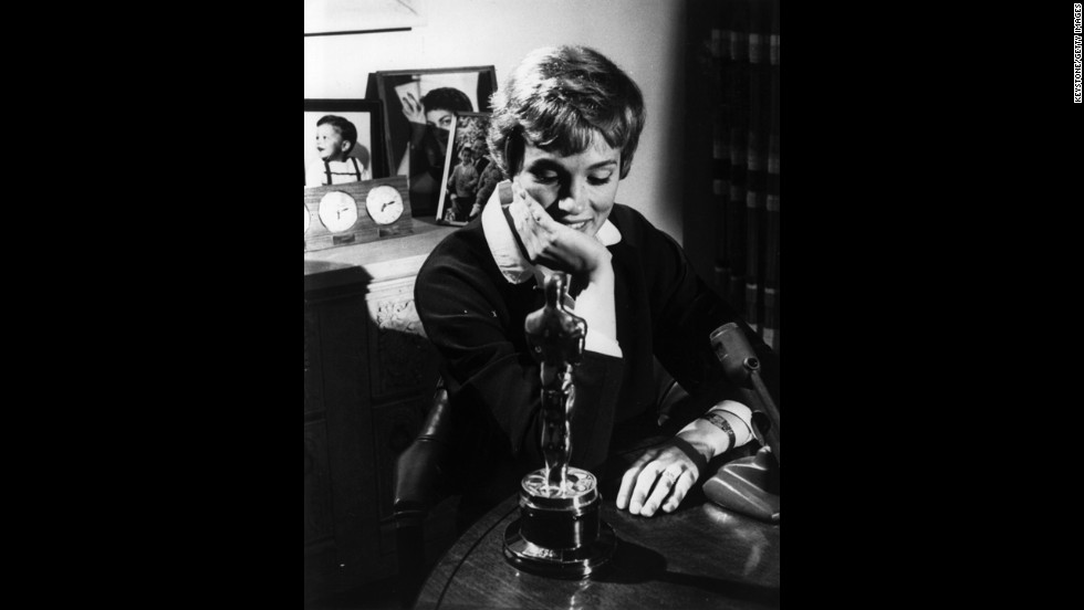"Julie Andrews looks at the Academy Award she won for ""Mary Poppins'"" in 1965. The role was her film debut."