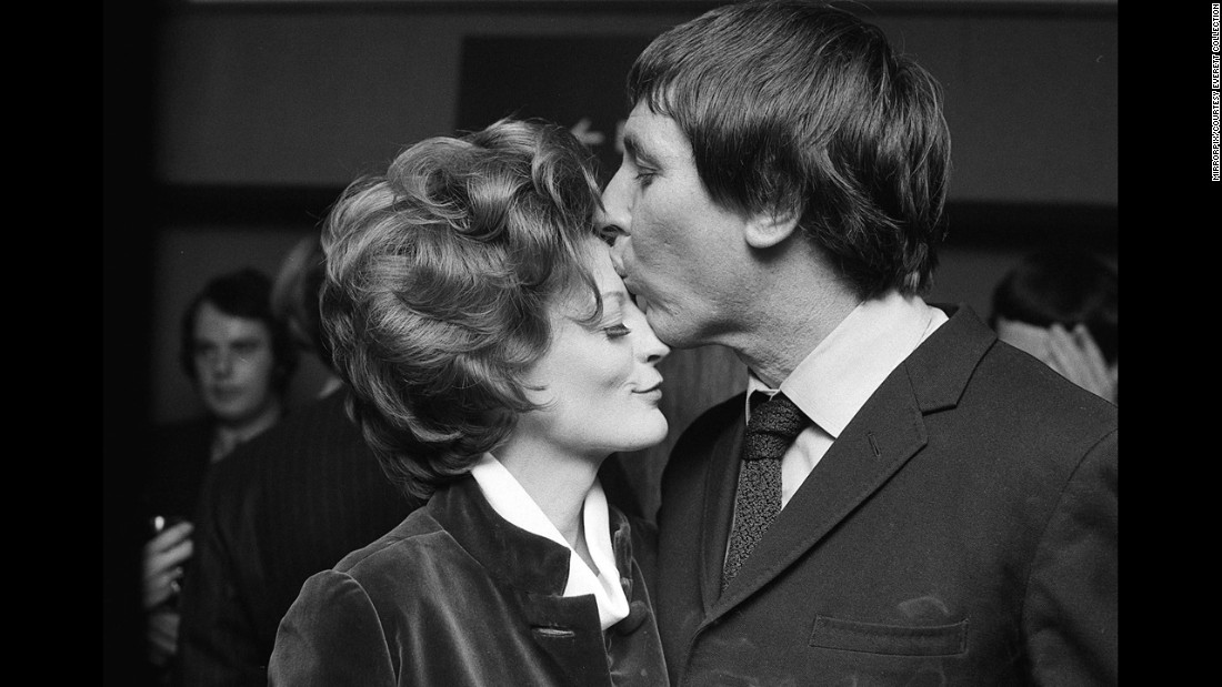 "Maggie Smith, who won for ""The Prime of Miss Jean Brodie,"" celebrates with her husband at the time, Robert Stephens."
