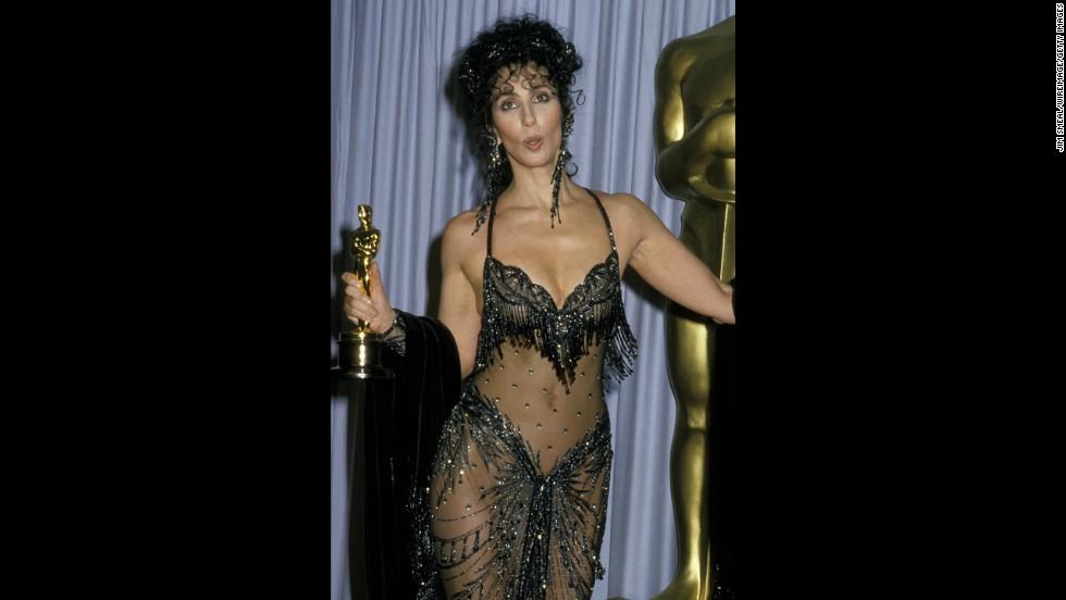"Cher wears <em>that</em> dress in 1988, when she won the Academy Award for ""Moonstruck."""