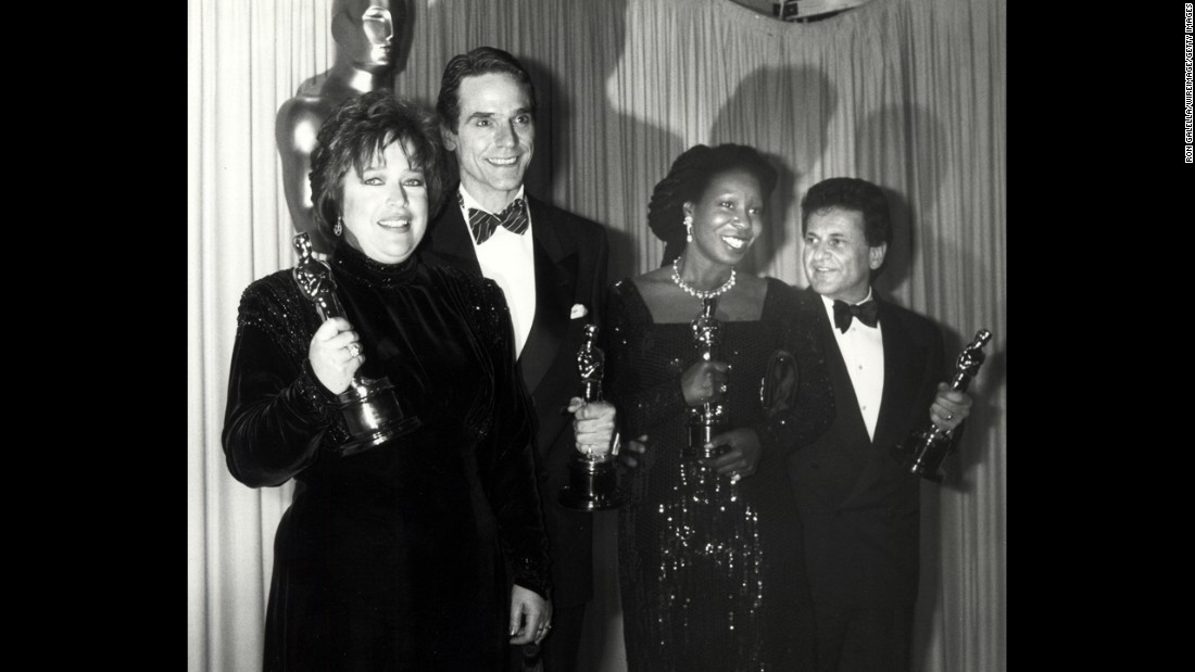 "Kathy Bates, far left, clutches the best actress award for her role in ""Misery."" To her left are fellow Oscar winners Jeremy Irons, Whoopi Goldberg and Joe Pesci."