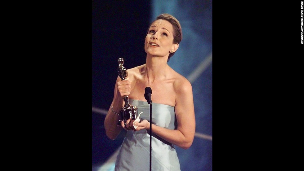"Helen Hunt holds her Oscar after winning for ""As Good As It Gets."""
