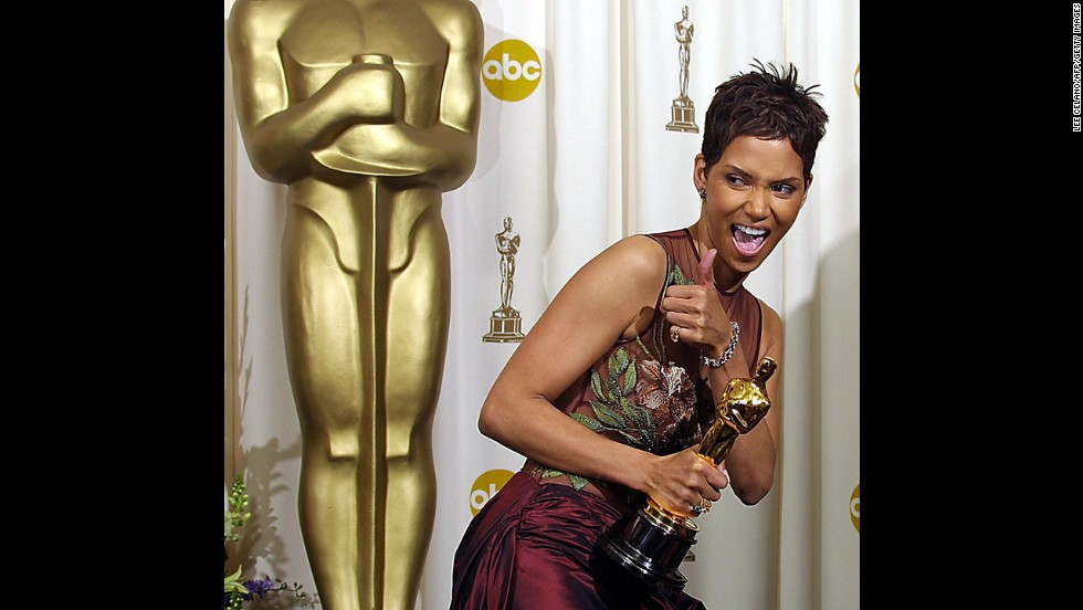 "Halle Berry celebrates as she holds her Oscar for ""Monster's Ball."" Berry is the only African-American to win the Oscar for best actress."