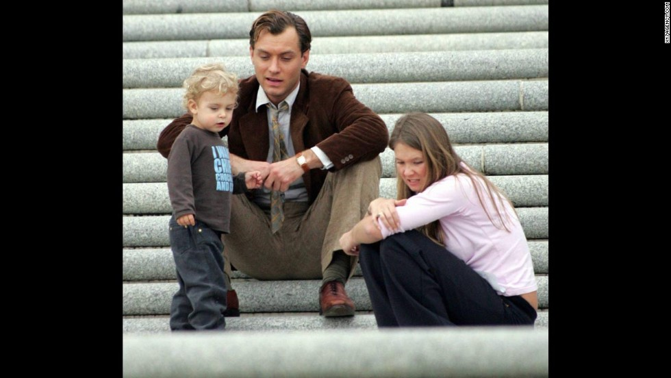 "In July 2005, Jude Law admitted to cheating on fiancée Sienna Miller with his kids' nanny, Daisy Knight (the pair is seen here on the set of ""All the King's Men"" in Louisiana in February 2005 with one of Law's children). In February 2014, Miller was quizzed about her relationship with Law when <a href=""http://www.cnn.com/2014/01/31/world/europe/uk-phone-hacking-trial/index.html"">she took the stand as part of Britain's phone hacking trial. </a>"