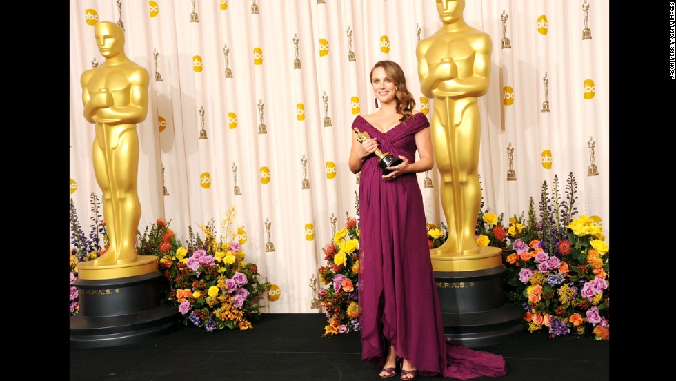"Natalie Portman poses in the press room after winning the best actress Oscar for ""Black Swan."""