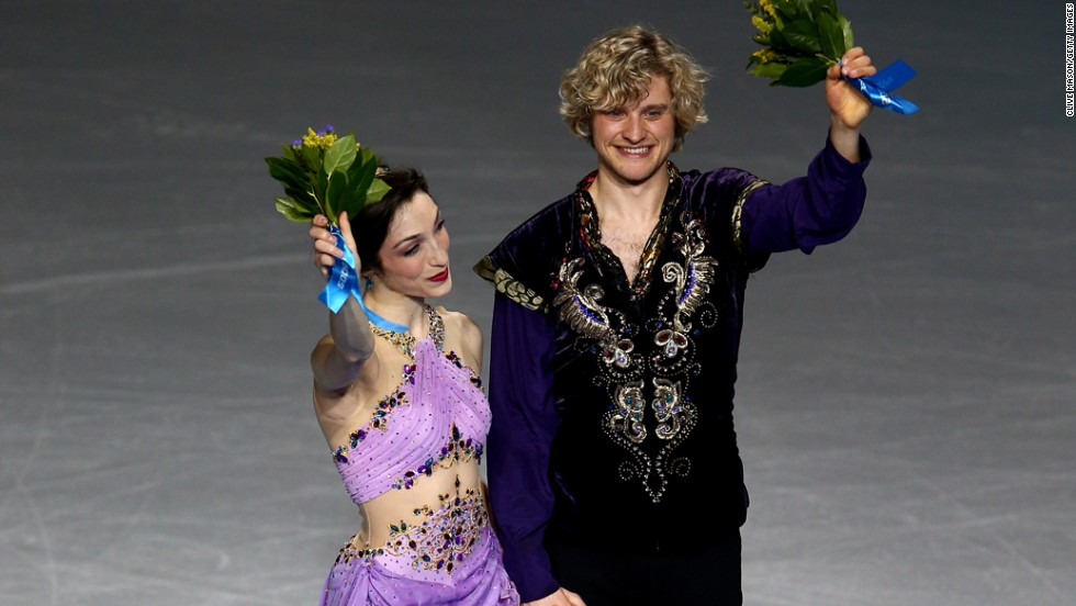 Davis and White celebrate on the podium during the flower ceremony. Canada's Tessa Virtue and Scott Moir, who won gold in 2010, finished in second this time. Russia's Elena Ilinykh and Nikita Katsalapov won the bronze.