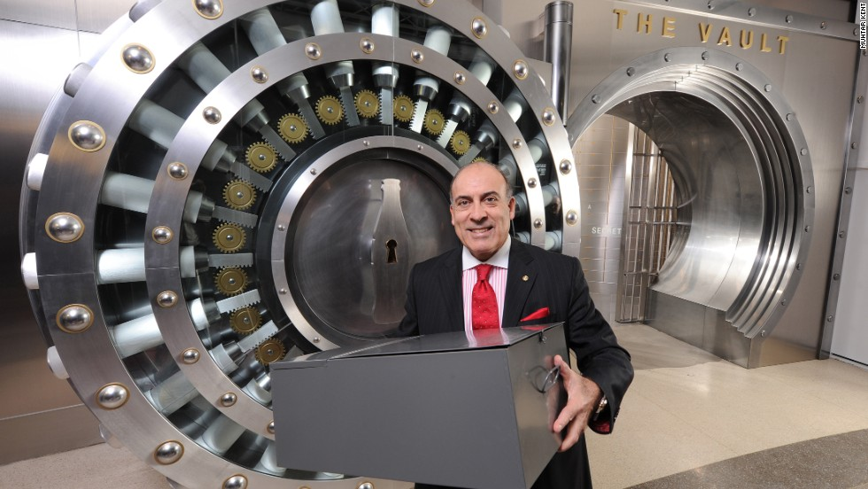 Muhtar Kent, the company's chief executive officer, shows the box containing the recipe, before it's placed inside the multi-million vault.
