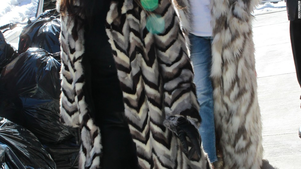 Kourtney Kardashian and Khloe Kardashian stay warm in New York City with full-length fur coats.