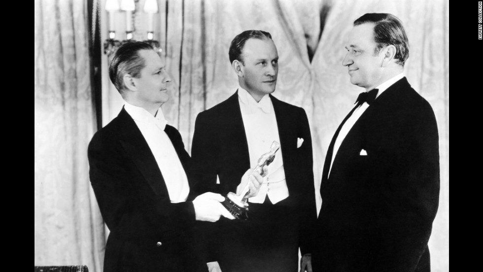 "The previous year's Oscar winner Lionel Barrymore, left, presents Wallace Beery, right, with the best actor Oscar for ""The Champ."" Beery tied that year with Fredric March in ""Dr. Jekyll and Mr. Hyde."""