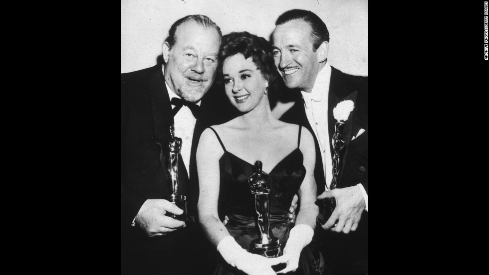 "David Niven, right, joins fellow Oscar winners Burl Ives and Susan Hayward at the 1959 ceremony after winning the best actor award for ""Separate Tables."" The actor fought off competition from Tony Curtis and Sidney Poitier, both up for ""The Defiant Ones""; Paul Newman in ""Cat on a Hot Tin Roof""; and Spencer Tracy in ""The Old Man and the Sea."""