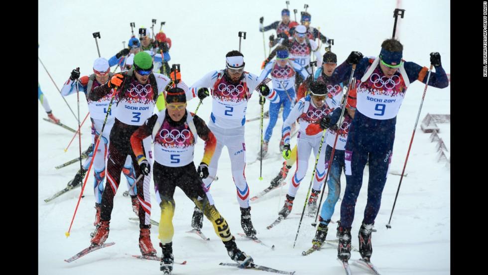 Biathletes compete in the men's 15-kilometer mass start event on February 18.