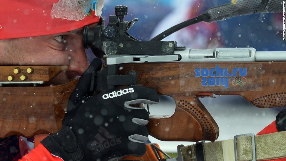 Russian biathlete Evgeniy Garanichev focuses on a shot during the men's 15-kilometer mass start.