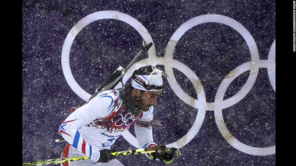 French biathlete Martin Fourcade competes in the 15-kilometer mass start event.