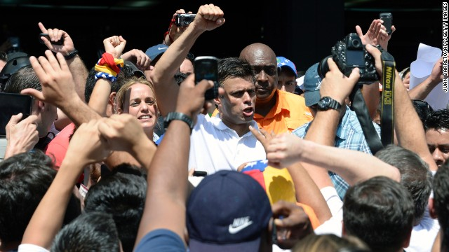 Opposition leader Leopoldo Lopez greets supporters during an opposition demonstration in Caracas on Wednesday, February 12.