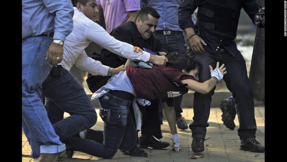 Police detain a student in Caracas on February 12.