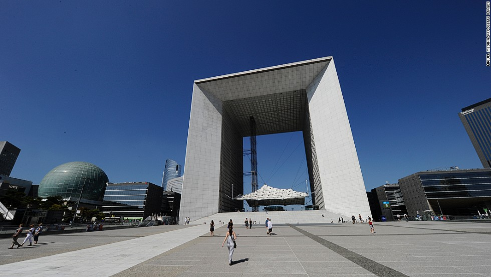 "In 1982 French president François Mitterrand staged an international design competition to create a ""modern Arc de Triomphe."" The Danish duo of Johann Otto von Spreckelsen and Erik Reitzel won with their Grande Arche de la Défense, which is meant to celebrate humanity rather than commemorate military conquest. Visitors don't just get a view of Paris through the Arc: there is also a viewing platform on its roof."