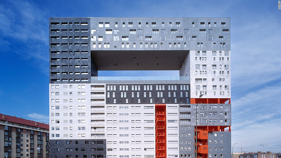 "Architectural firm MVRDV did not run out of money before completing <a href=""http://www.mvrdv.nl/projects/mirador/"" target=""_blank"">The Mirador</a> apartment complex in Madrid. The hole in the middle is actually a semi-public sky plaza which provides an ideal vantage point to enjoy the nearby Guadarrama Mountains. It also includes a community garden, thereby ""monumentalizing public life and space."""