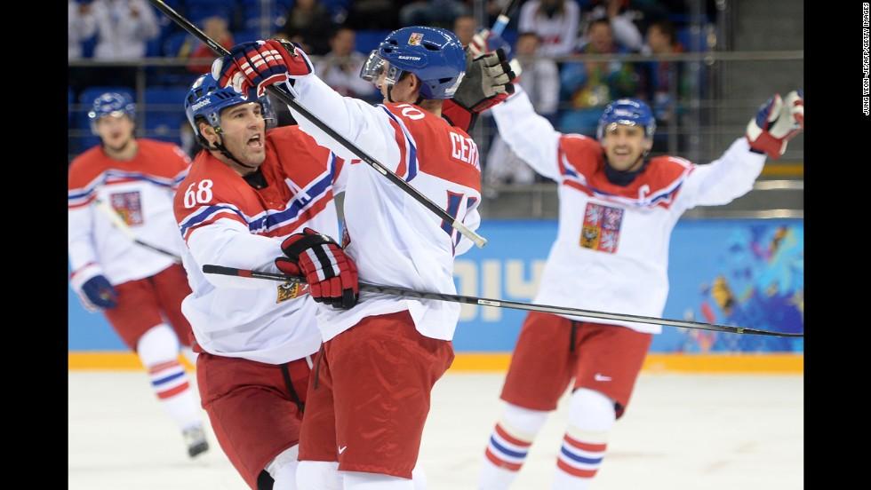 Roman Cervenka and Jaromir Jagr celebrate a goal for the Czech Republic during the men's ice hockey game against Slovakia on February 18.