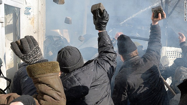 Anti-government protesters throw rocks during clashes with police in front of the Ukrainian Parliment in Kiev on February 18, 2014. At least three anti-government protesters were killed and some 150 others injured, some seriously, today in fresh clashes between police and demonstrators protesting near Ukraine's parliament building in Kiev. Medics at an opposition-run field hospital said that most of the injuries were caused by stun grenades while some of the 30 people in a serious condition had suffered head injuries, and one person had to have a hand amputated. AFP PHOTO / SERGEI SUPINSKYSERGEI SUPINSKY/AFP/Getty Images