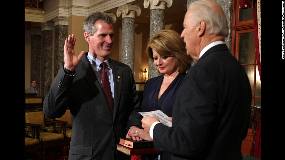Vice President Joe Biden swears in Massachusetts Republican Scott Brown to the U.S. Senate following his special election win in 2010. Brown's wife, Gail Huff, holds two bibles of their daughters.