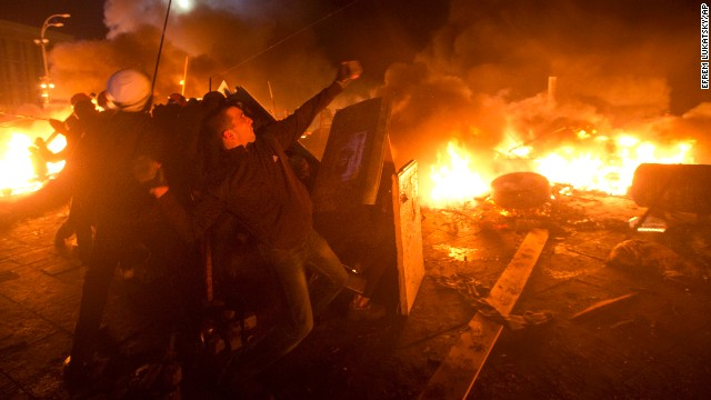 Ukrainian protesters clash with riot police in Kiev's Independence Square, the epicenter of the country's current unrest, on Tuesday, February 18.