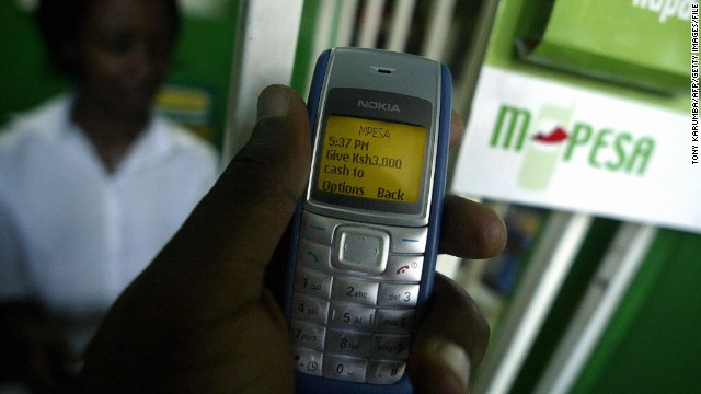Photo taken 23 April 2007 shows a man sending money through a pioneering mobile phone service called M-Pesa, in Kenya's capital, Nairobi. M-Pesa [Pesa being swahili for money] has sky-rocketed in popularity for its low costs and convenience as users can send and receive money from remote areas through a mobile handset and at onlt a fraction of the cost of sending money through banks, courier and money transfer services. AFP PHOTO/TONY KARUMBA (Photo credit should read TONY KARUMBA/AFP/Getty Images)