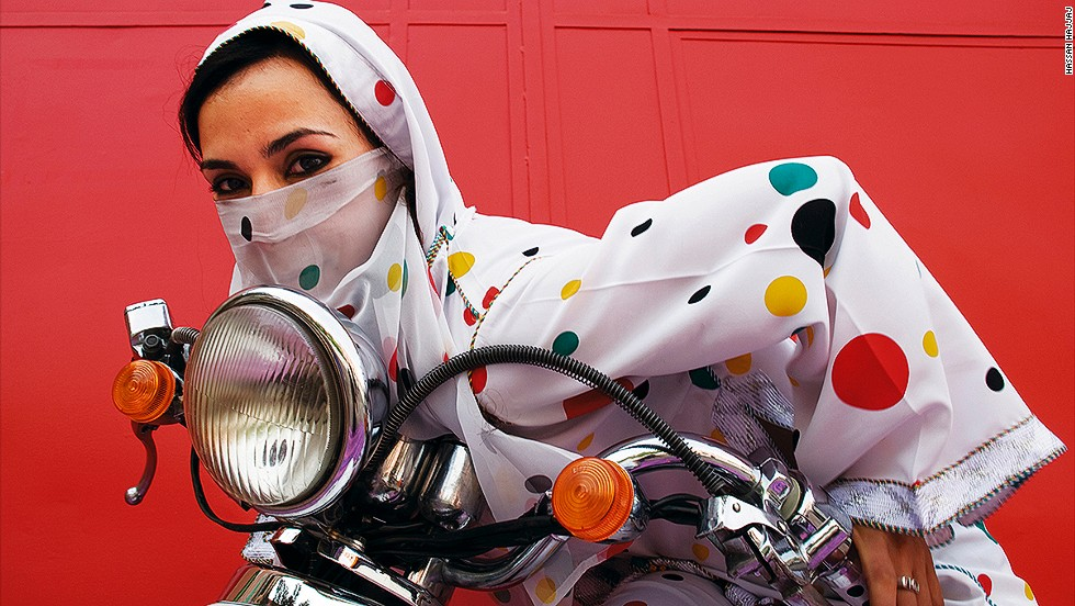 "And that vibe includes plenty of independent women. Marrakech motorcycle culture welcomes everyone and society does not look down on female riders. ""Journalists often ask, 'What do you think of women being covered up?'"" Hajjaj says. ""I find that silly. It's traditional clothing. It's not like anyone is holding a staff over them."""