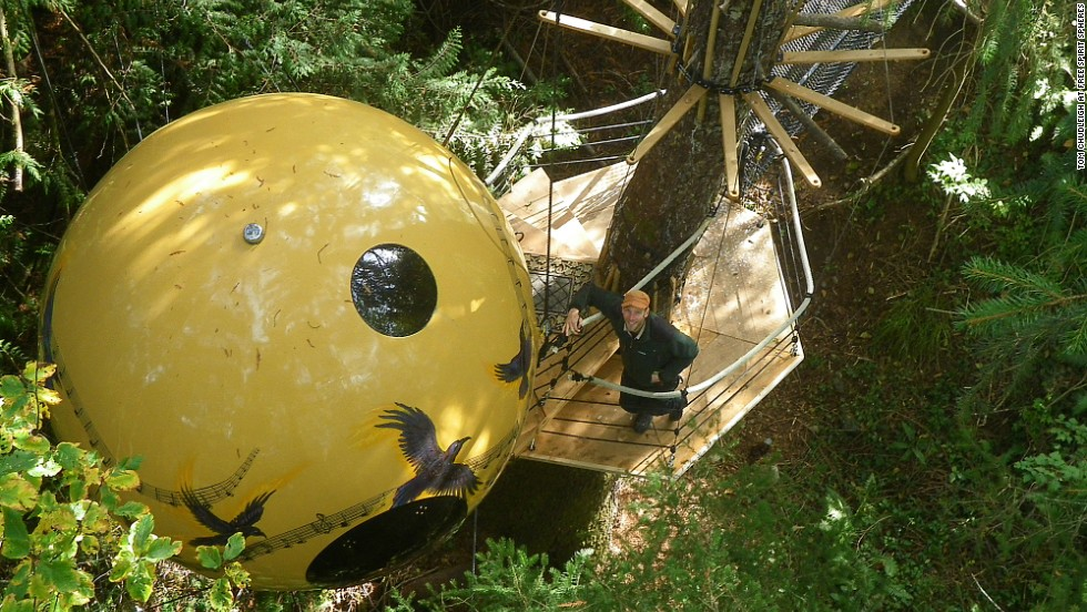 Climb rope staircases or steel bridges to access the swinging handmade orb where your bed is located at Free Spirit Spheres. Other facilities, such as a kitchen and showers, are located below on ground level.