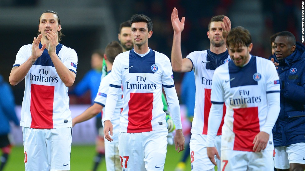 PSG players applaud their fans after their 4-0 victory all but guarantees their place in the quarterfinals.