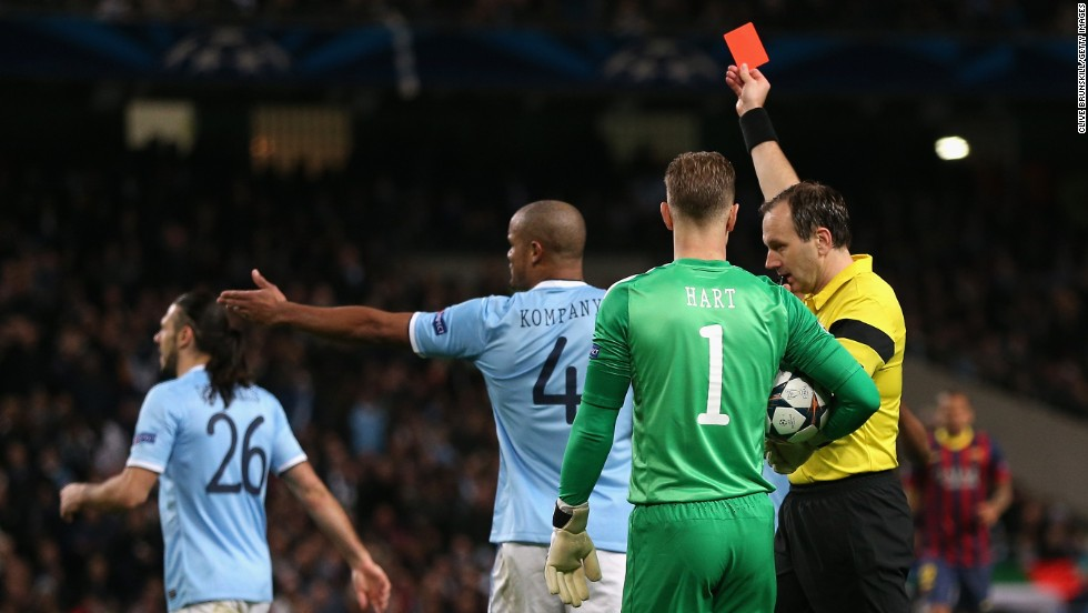 Referee Jonas Eriksson shows a red card to Martin Demichelis after his foul on Messi led to the penalty. While the City player may have few complaints about his dismissal, he may argue that his tackle on Messi took place outside the area.