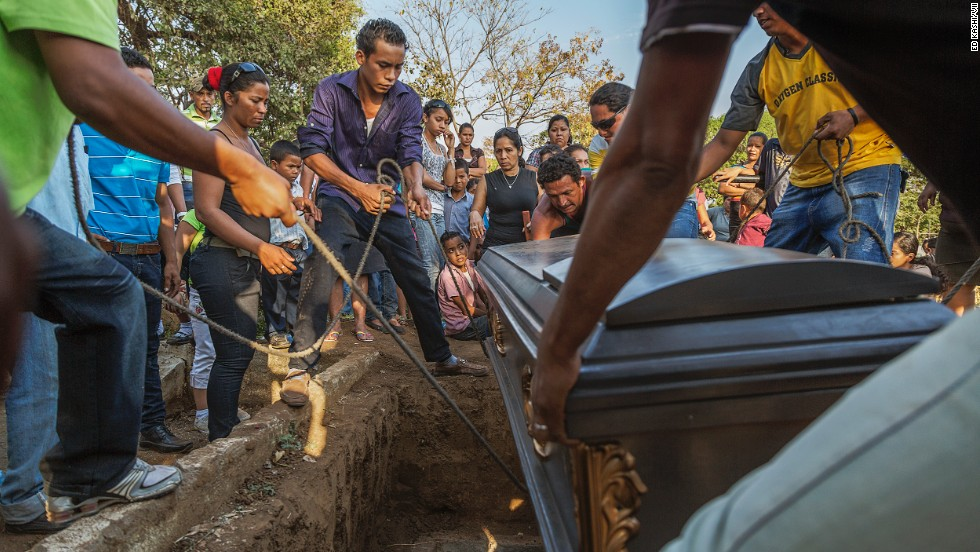 "The casket is lowered at a funeral for a 49-year-old sugar cane worker in Chichigalpa, Nicaragua. Mortality rates from chronic kidney disease in La Isla community are so high that it is now called La Isla de Viudas, or ""The Island of Widows."""