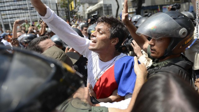 Leopoldo Lopez, an ardent opponent of Venezuela's socialist government, is escorted by members of the national guard on Tuesday, February 18, after President Nicolas Maduro ordered his arrest on charges of homicide and inciting violence.