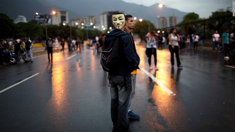 Demonstrators stand on a highway during a protest outside La Carlota airport in Caracas on February 18.