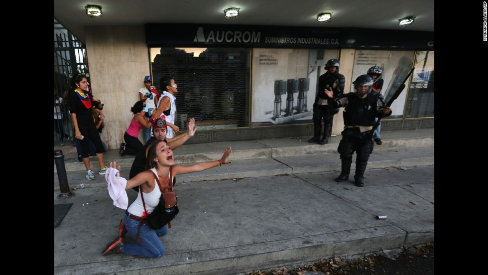 A demonstrator shouts for riot police not to fire tear gas in Caracas on Saturday, February 15.