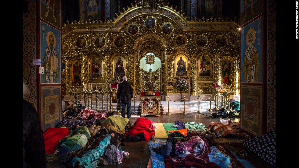 Protesters sleep on the floor inside a Kiev monastery on February 19.